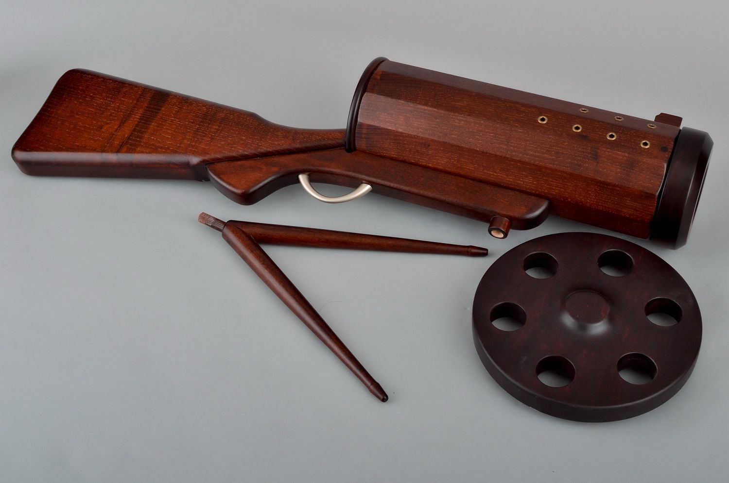 Wooden wine bottle stand in the form of a gun photo 5