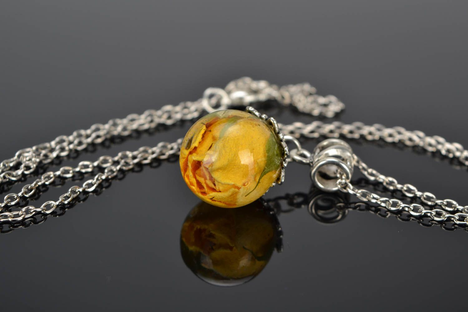 Pendant with rose on a long chain photo 1