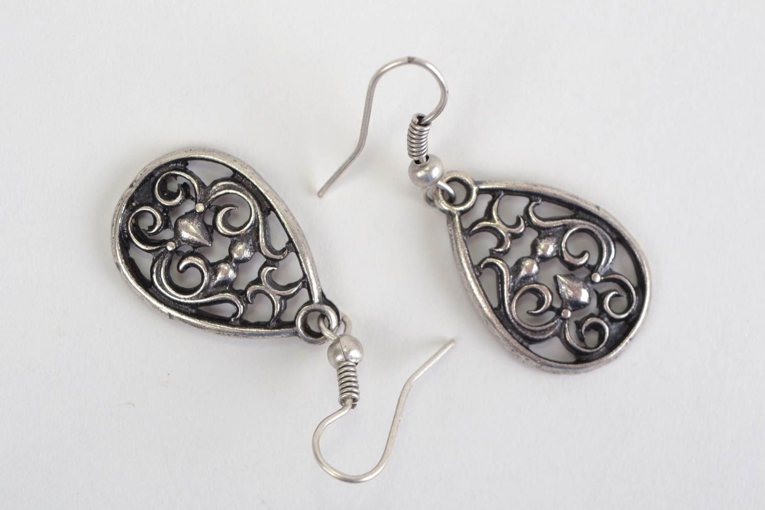 Beautiful handmade design metal lace earrings of silvery color photo 1
