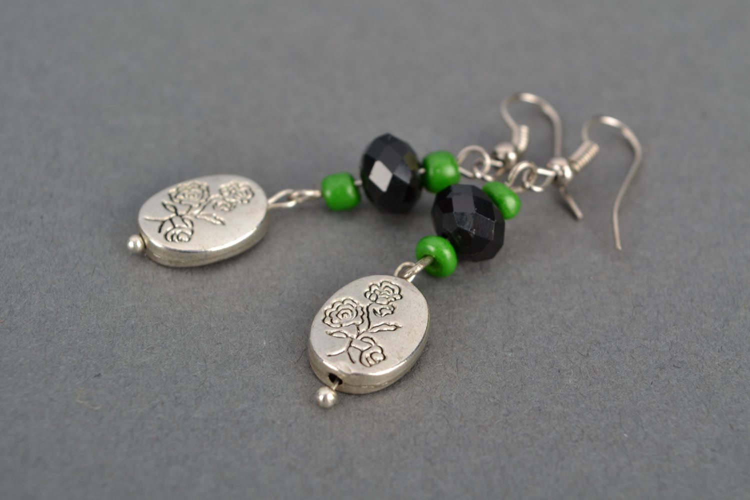 Long earrings with metal charms photo 4