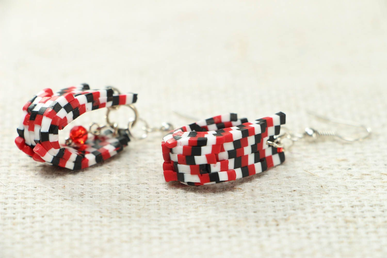 Stylish plastic earrings photo 2