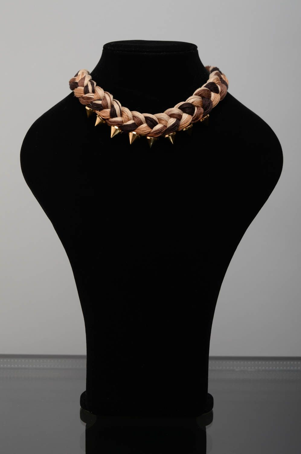 Woven necklace with metal studs photo 1