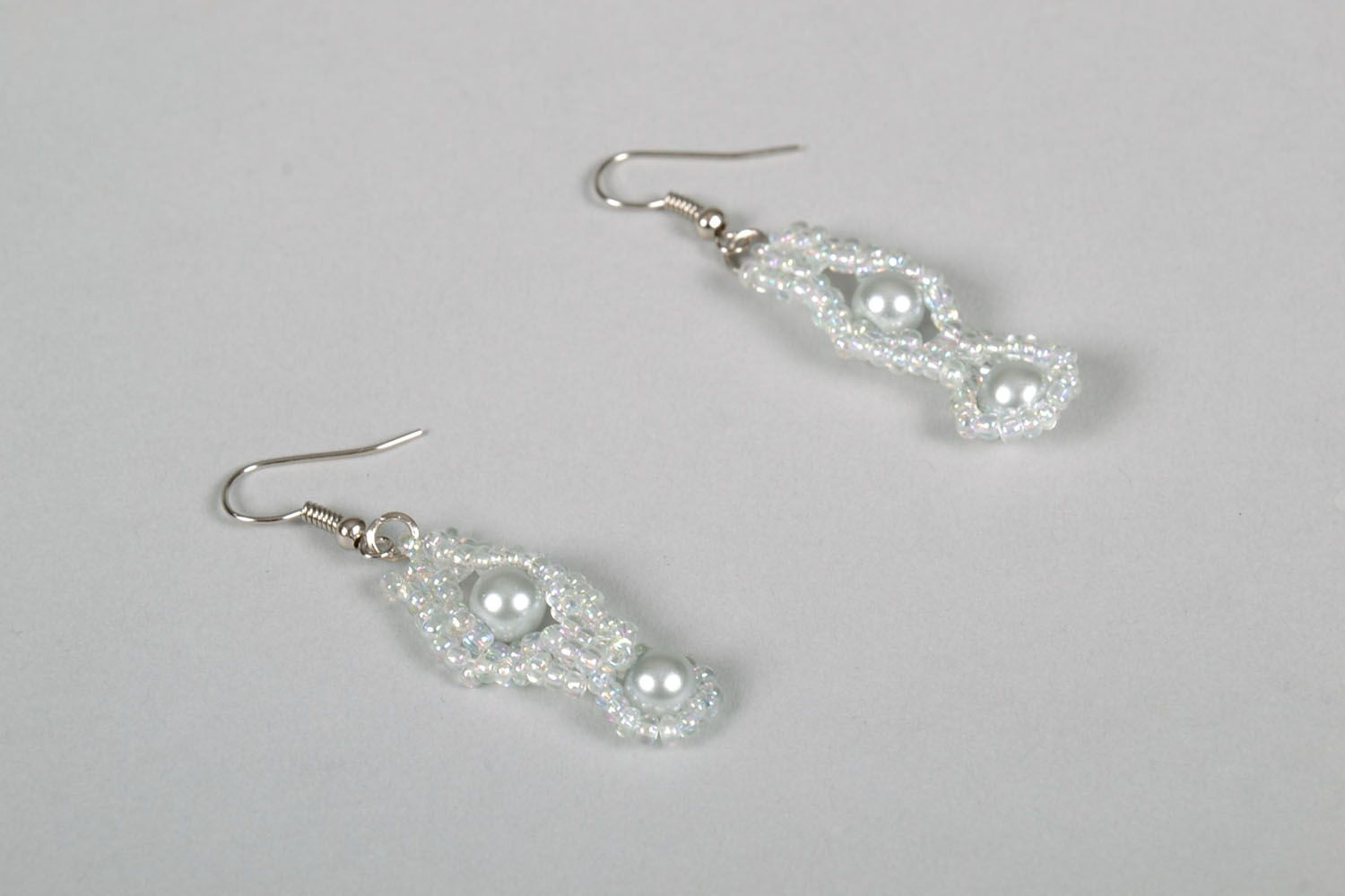White earrings with artificial pearls photo 3