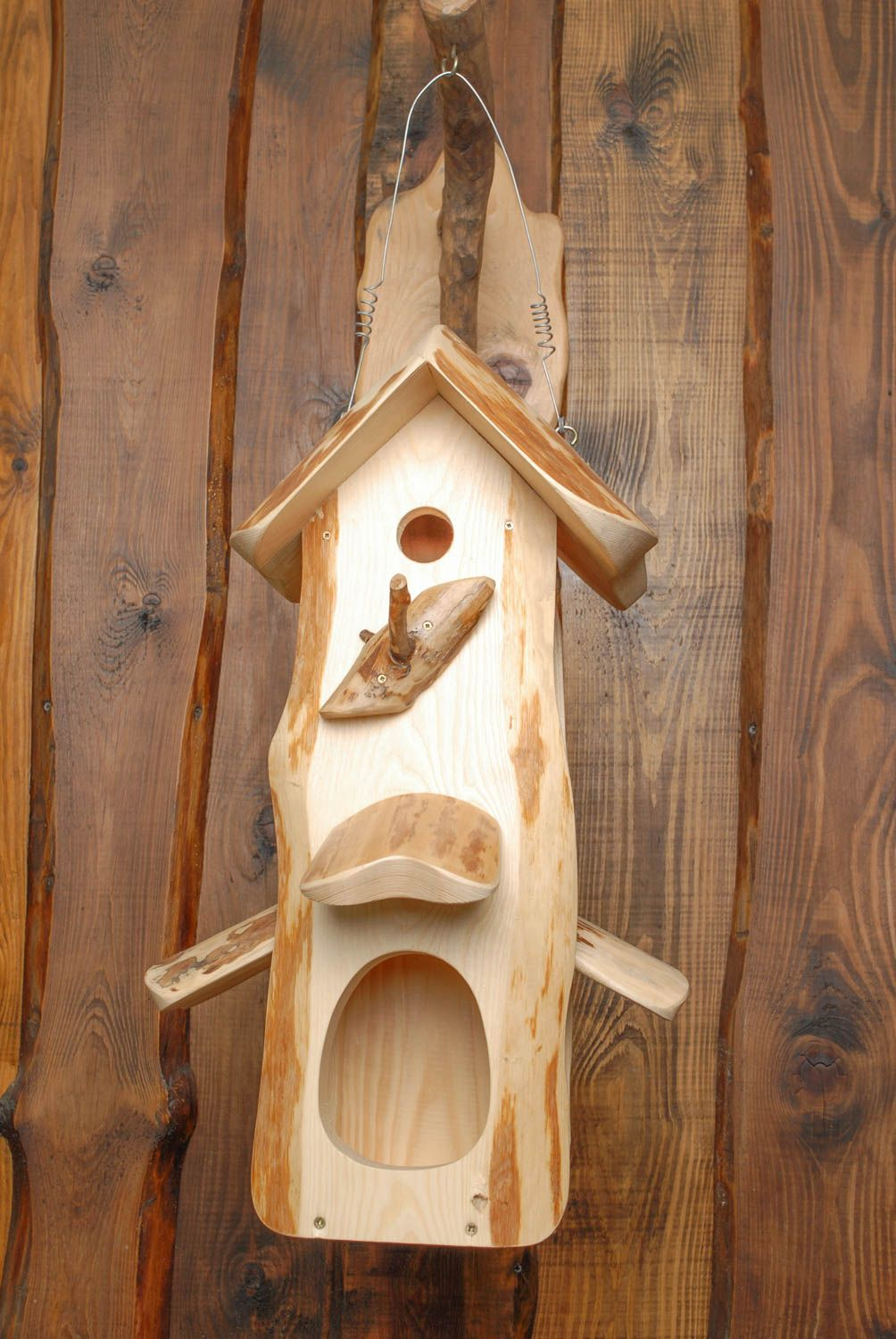 ... this wooden birdhouse is also an interesting bird feeder it is made