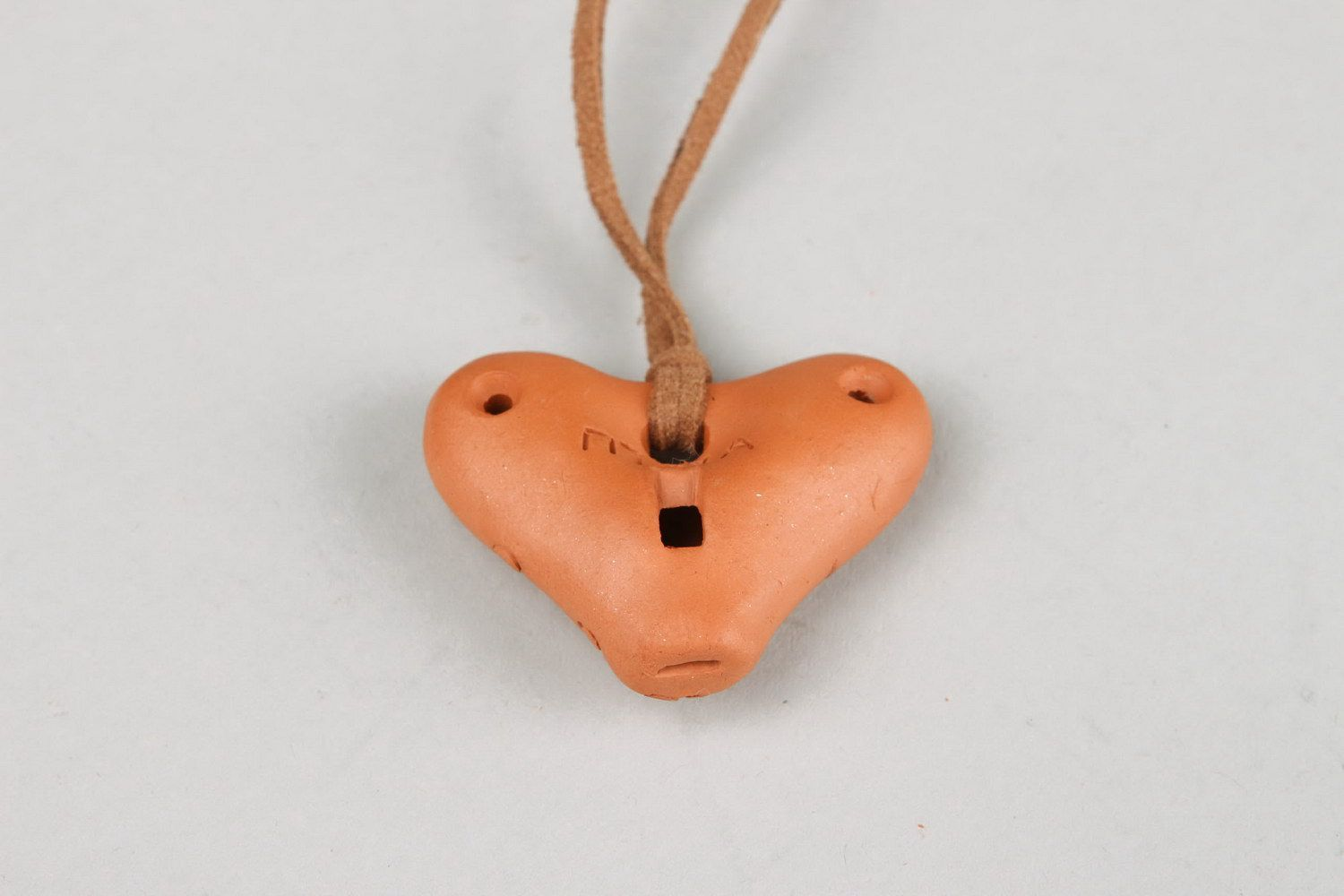 Heart-shaped tin whistle pendant made of clay  photo 2