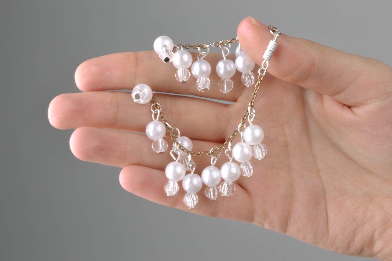 Bracelet made of white beads photo 6