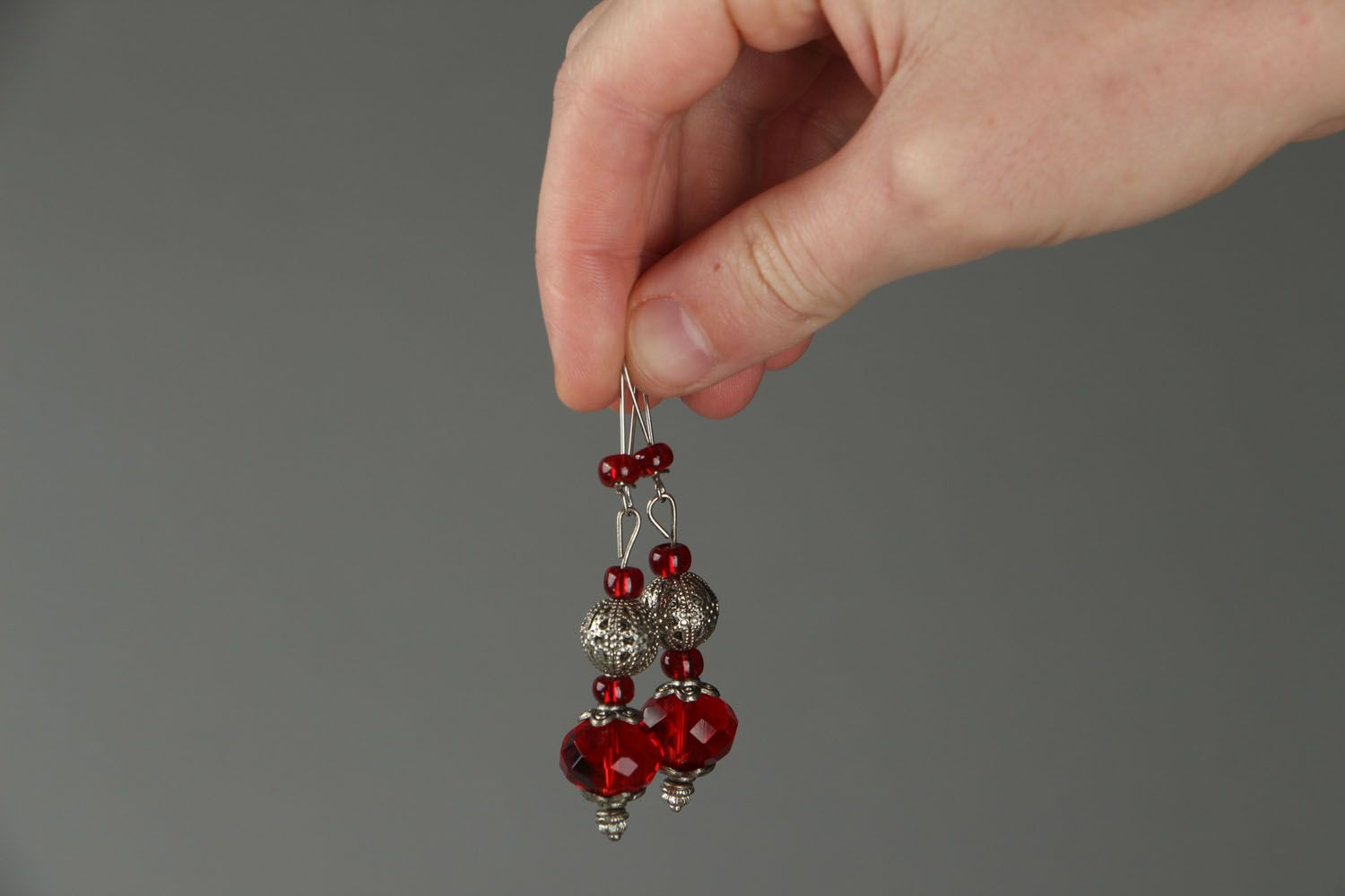 Earrings made of red plastic beads photo 3