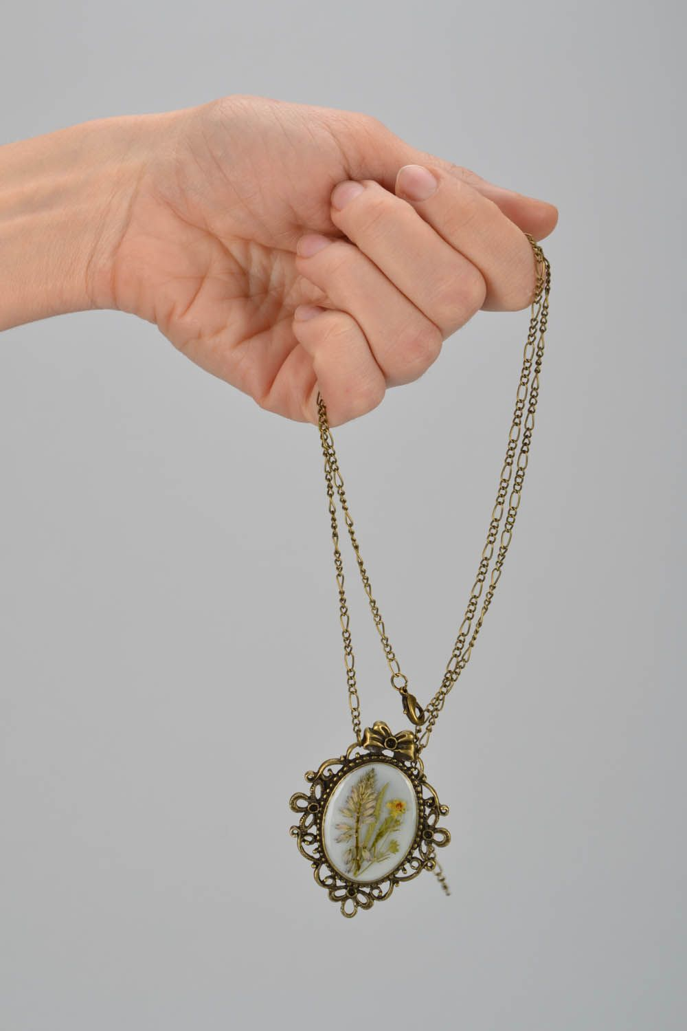 Locket with dry flowers photo 2