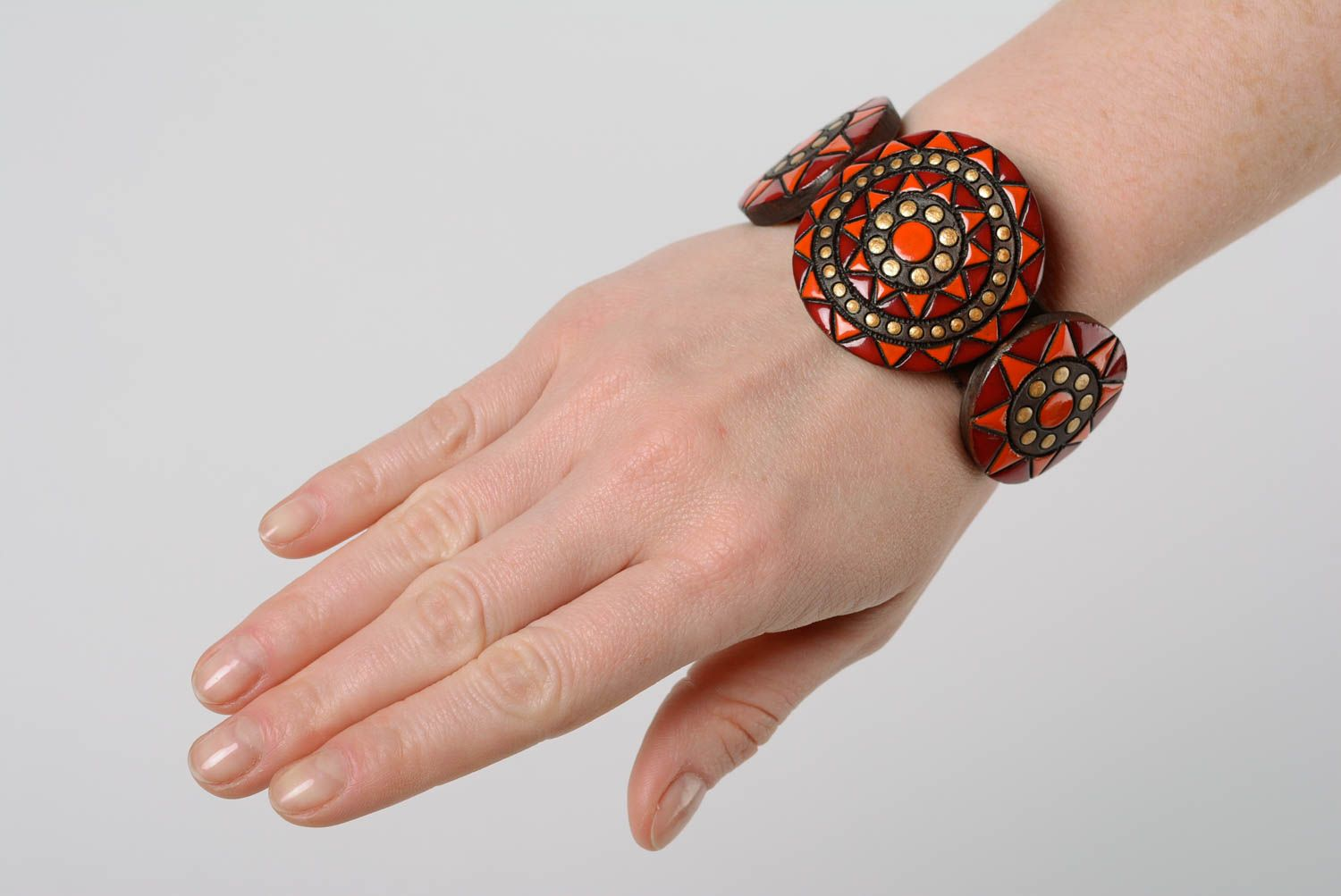 clay bracelets Handmade large clay bracelet ornamented with paints and equipped with leather strap - MADEheart.com