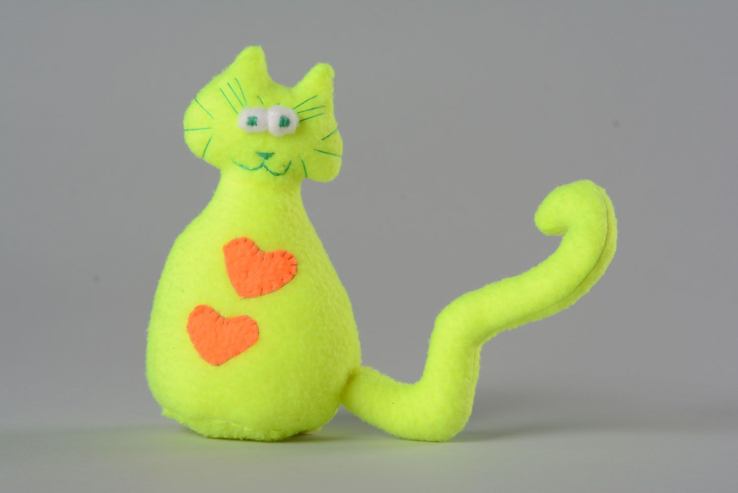 Soft toy in the shape of a yellow and green cat photo 1