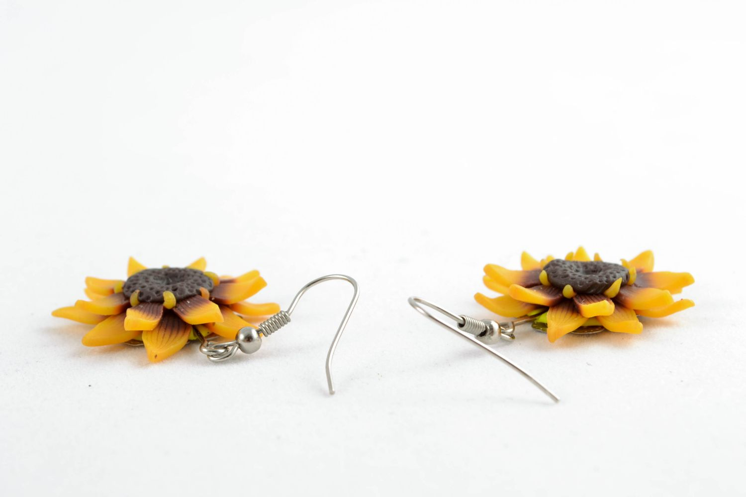 Polymer clay earrings in the shape of sunflowers photo 4