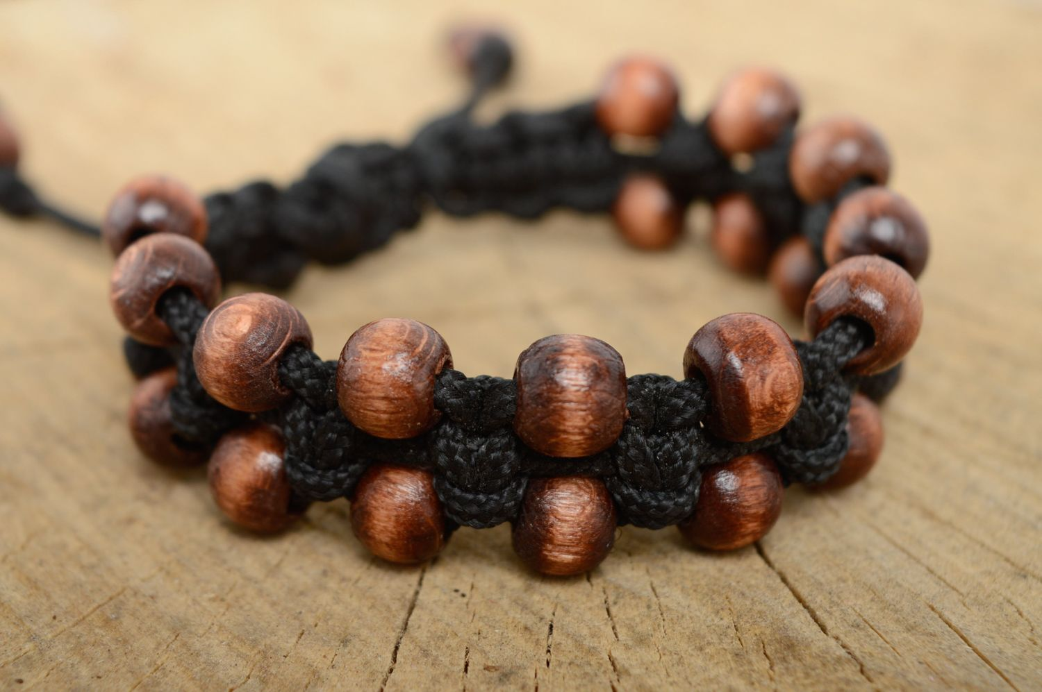 Macrame woven cord bracelet with wooden beads photo 1