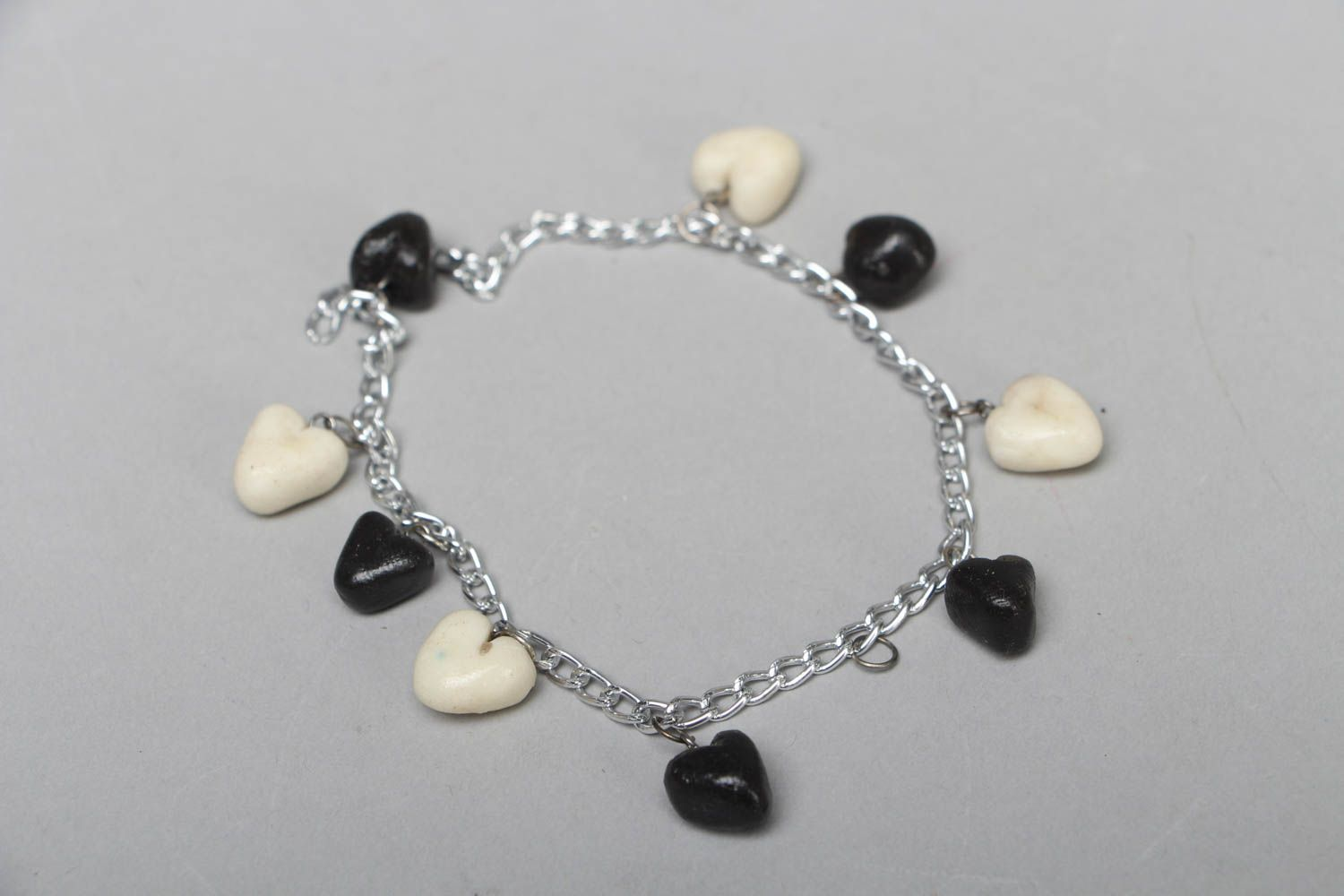 Polymer clay bracelet with heart-shaped charms photo 1