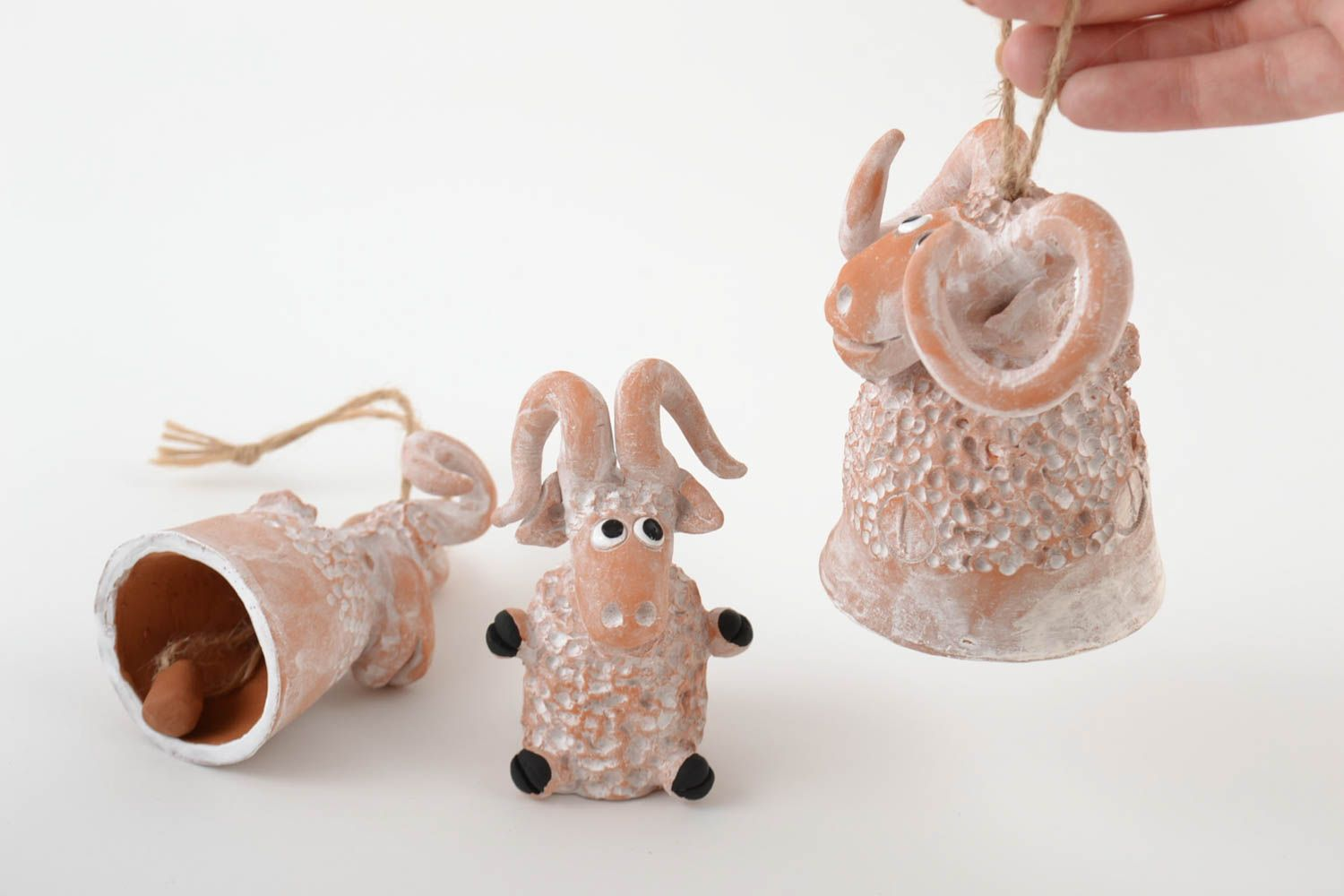 Handmade ceramic figured bells and figurine in the shape of lambs set of 3 items photo 2