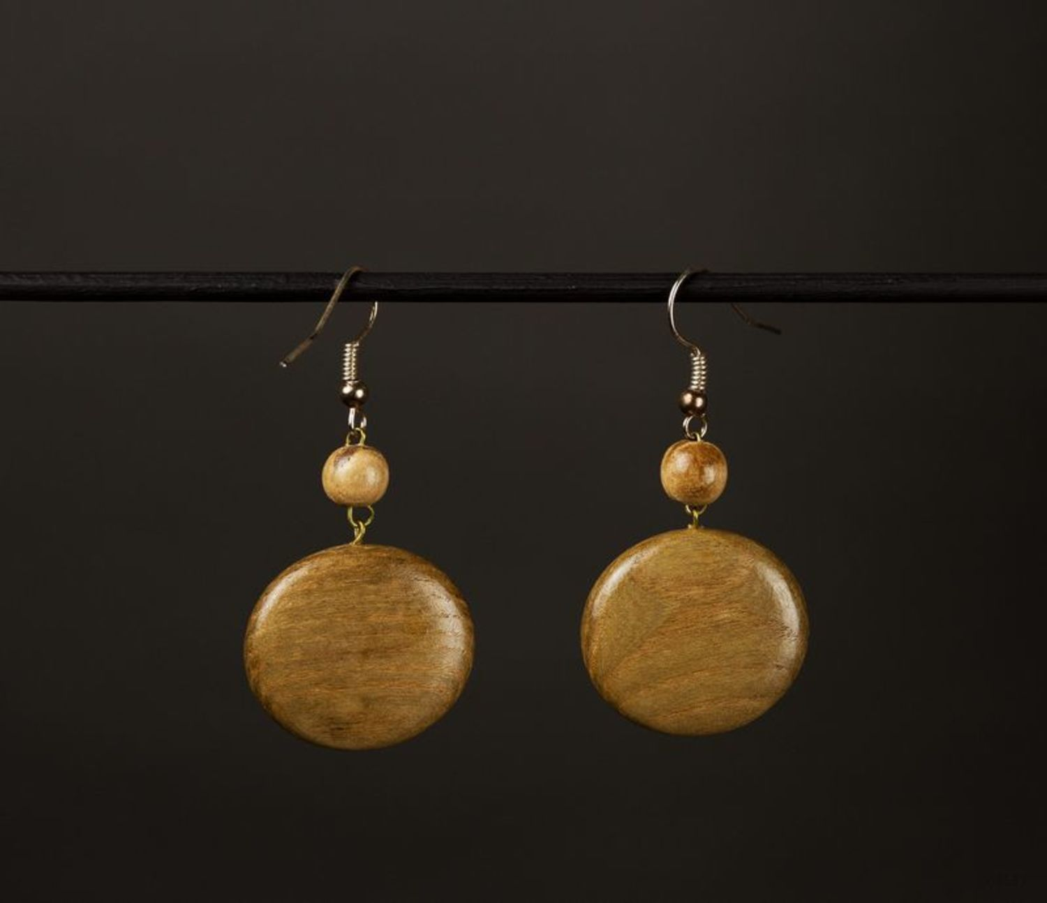 Round handmade wooden earrings photo 1