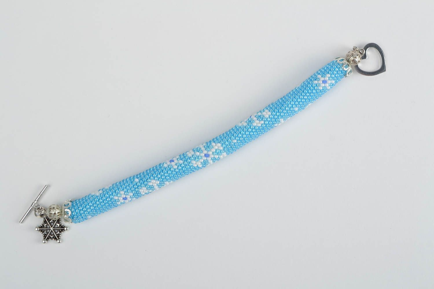 Beautiful handmade woven beaded cord bracelet of blue color with charm Snowflake photo 3