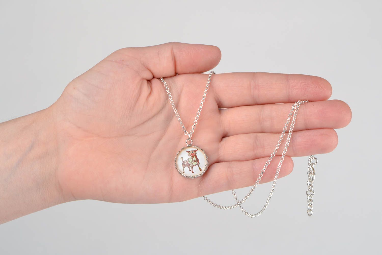 Handmade designer round white glass pendant on chain with image of Taurus photo 2