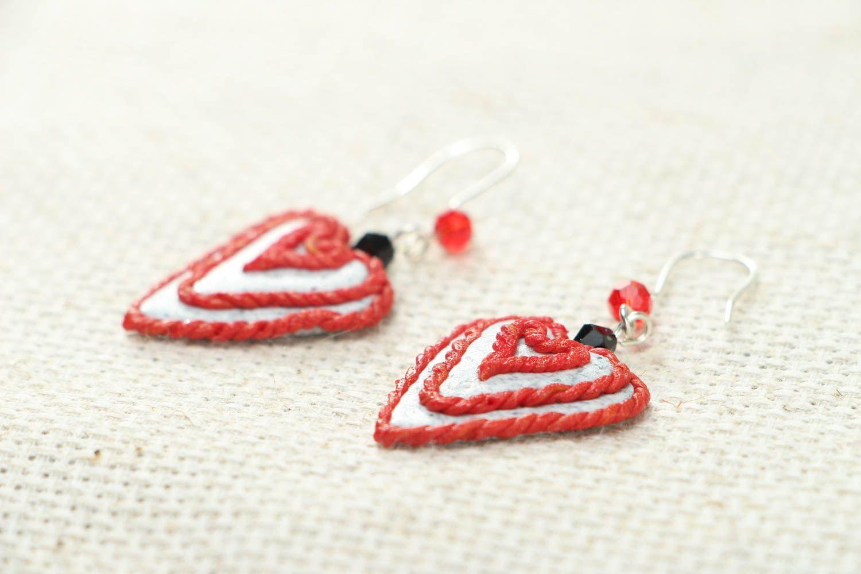 Heart-shaped plastic earrings photo 2