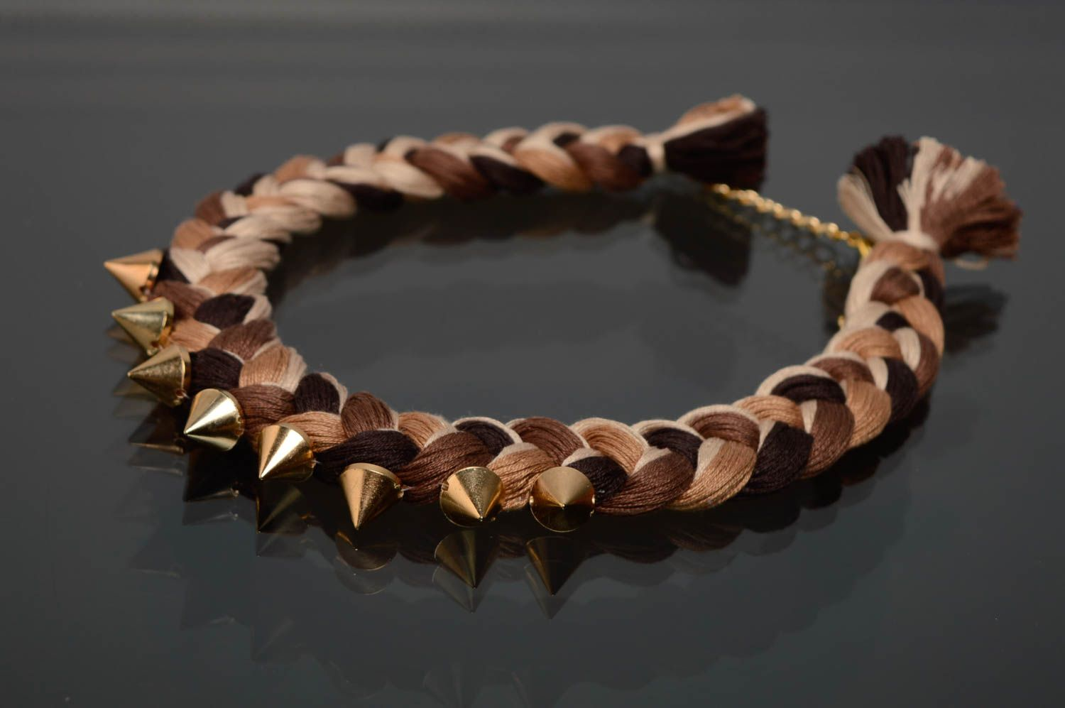 Woven necklace with metal studs photo 2