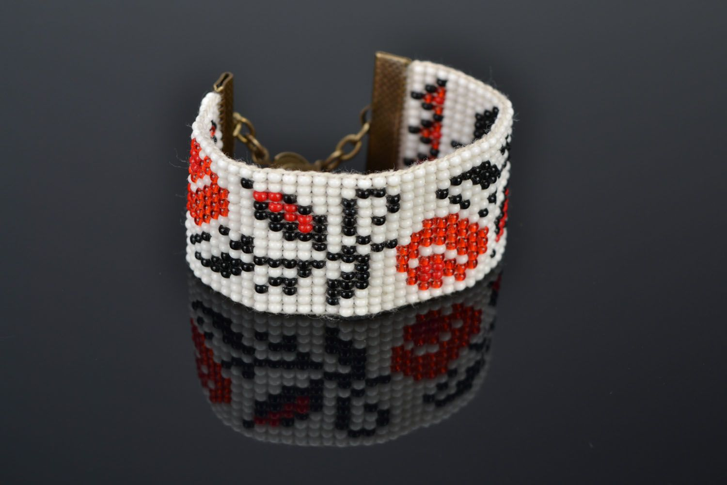 Wide beaded bracelet with ethnic pattern photo 1