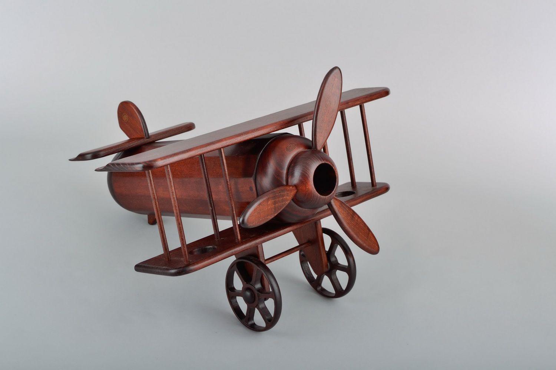 Wooden wine bottle stand Plane photo 1