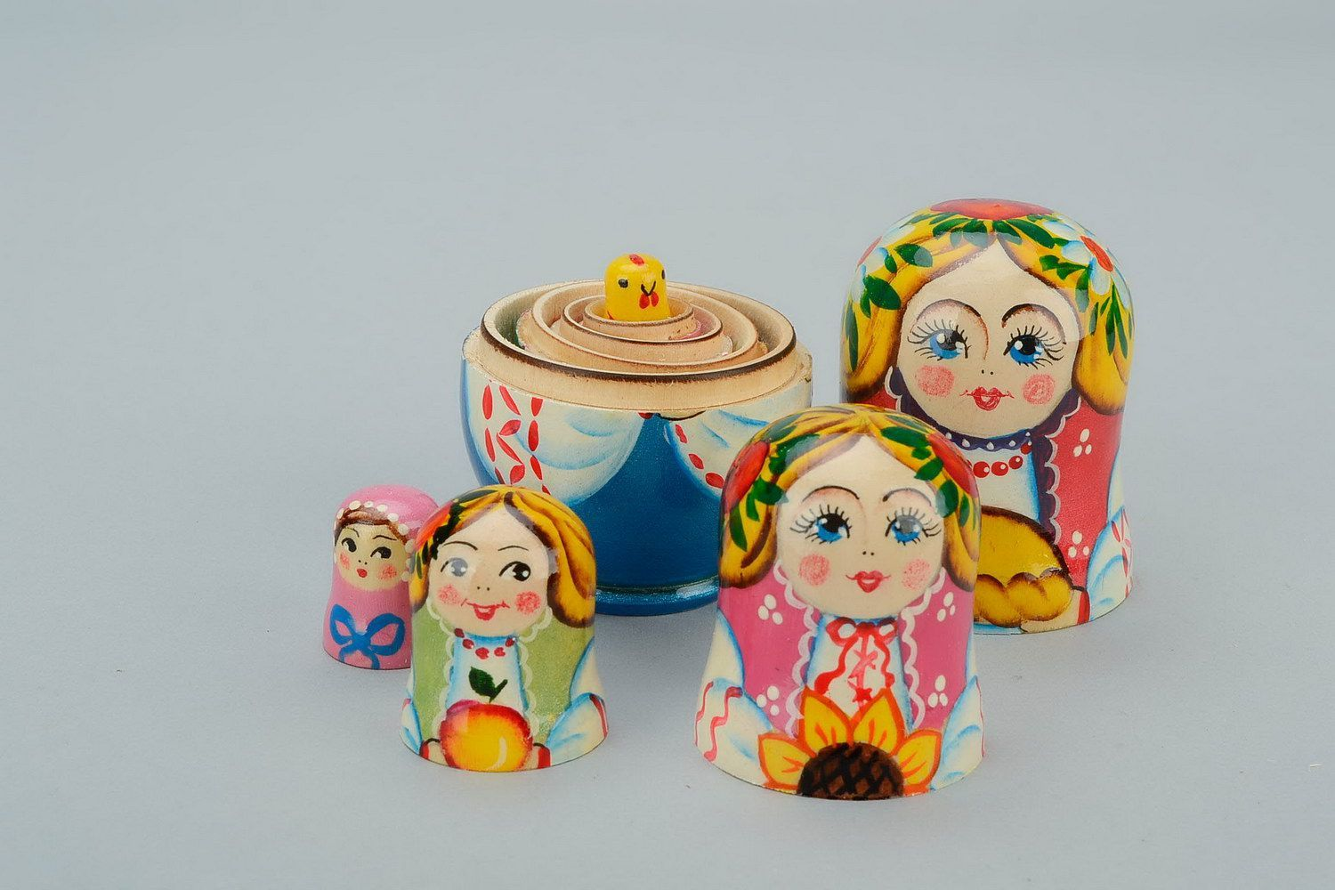 Wooden matryoshka doll with loaf photo 1
