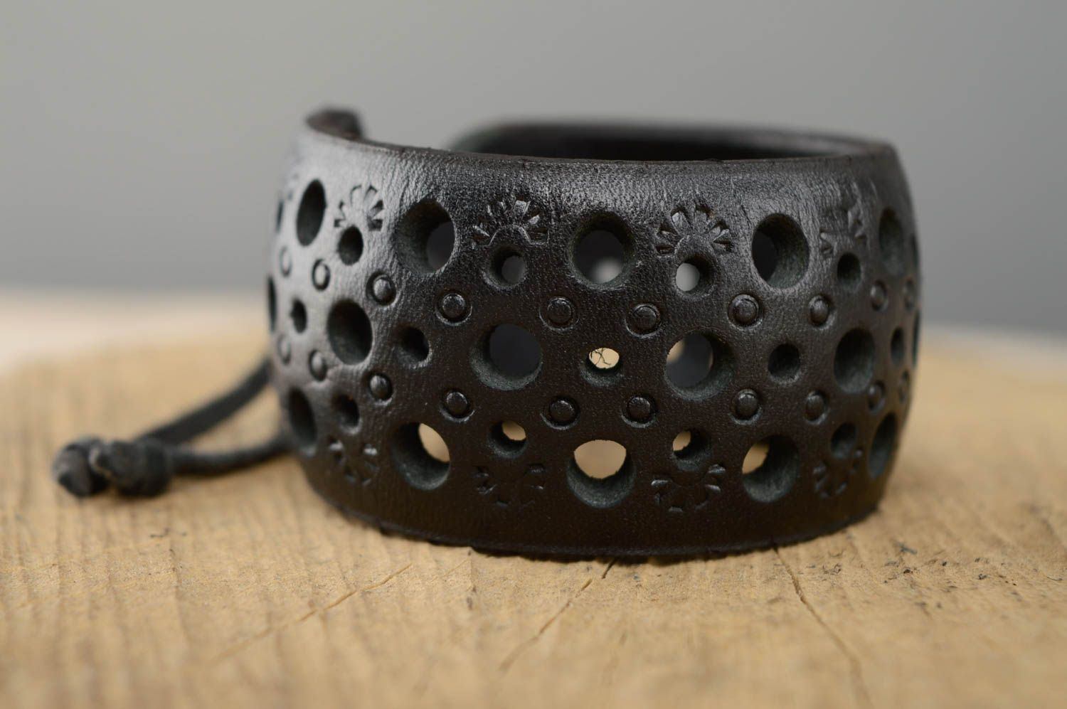 Wide leather bracelet with carving and embossing photo 1