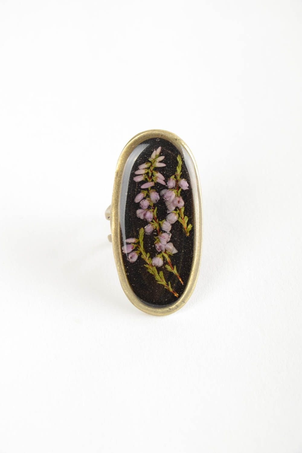 Beautiful women's handmade oval top ring with dried flowers coated with epoxy photo 4