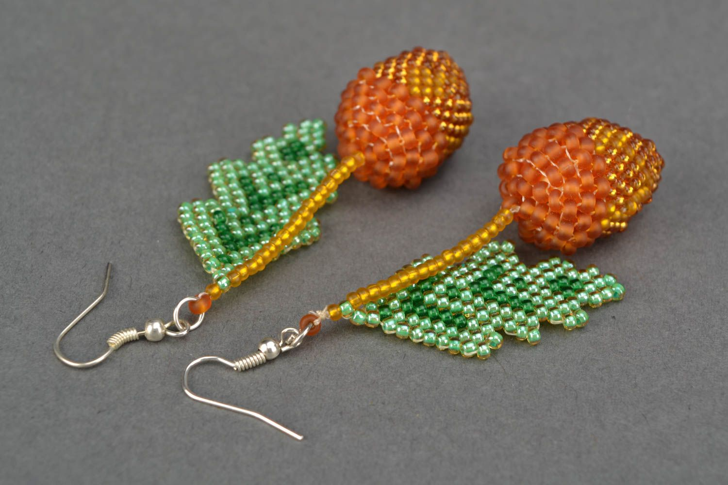 Beaded earrings with acorn charms photo 4