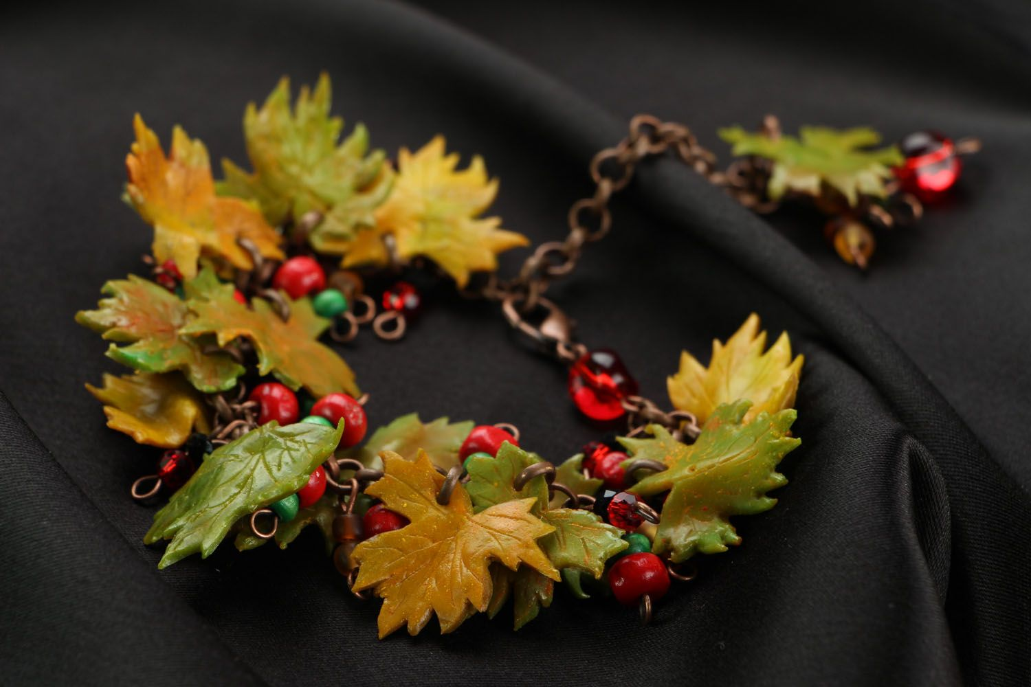 Plastic bracelet with charms in the shape of leaves photo 2