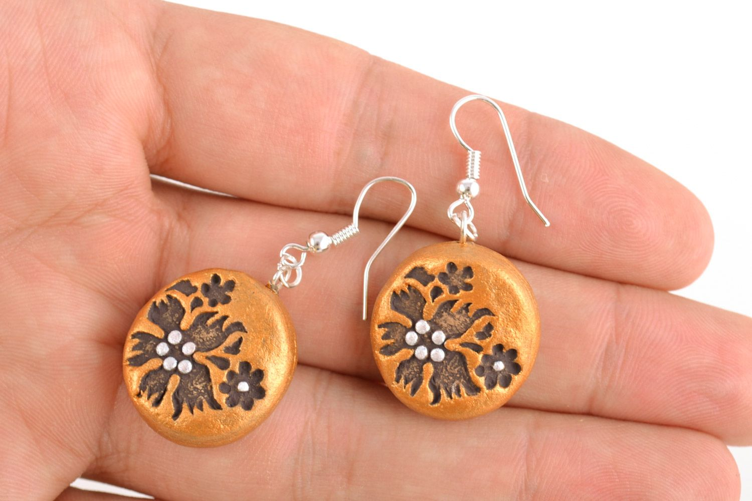 Handmade dangle clay round earrings of gold color with patterns photo 2