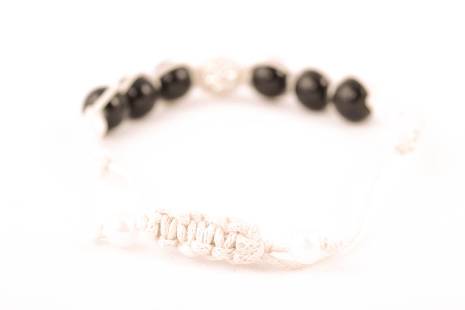 Woven bracelet with black beads photo 2