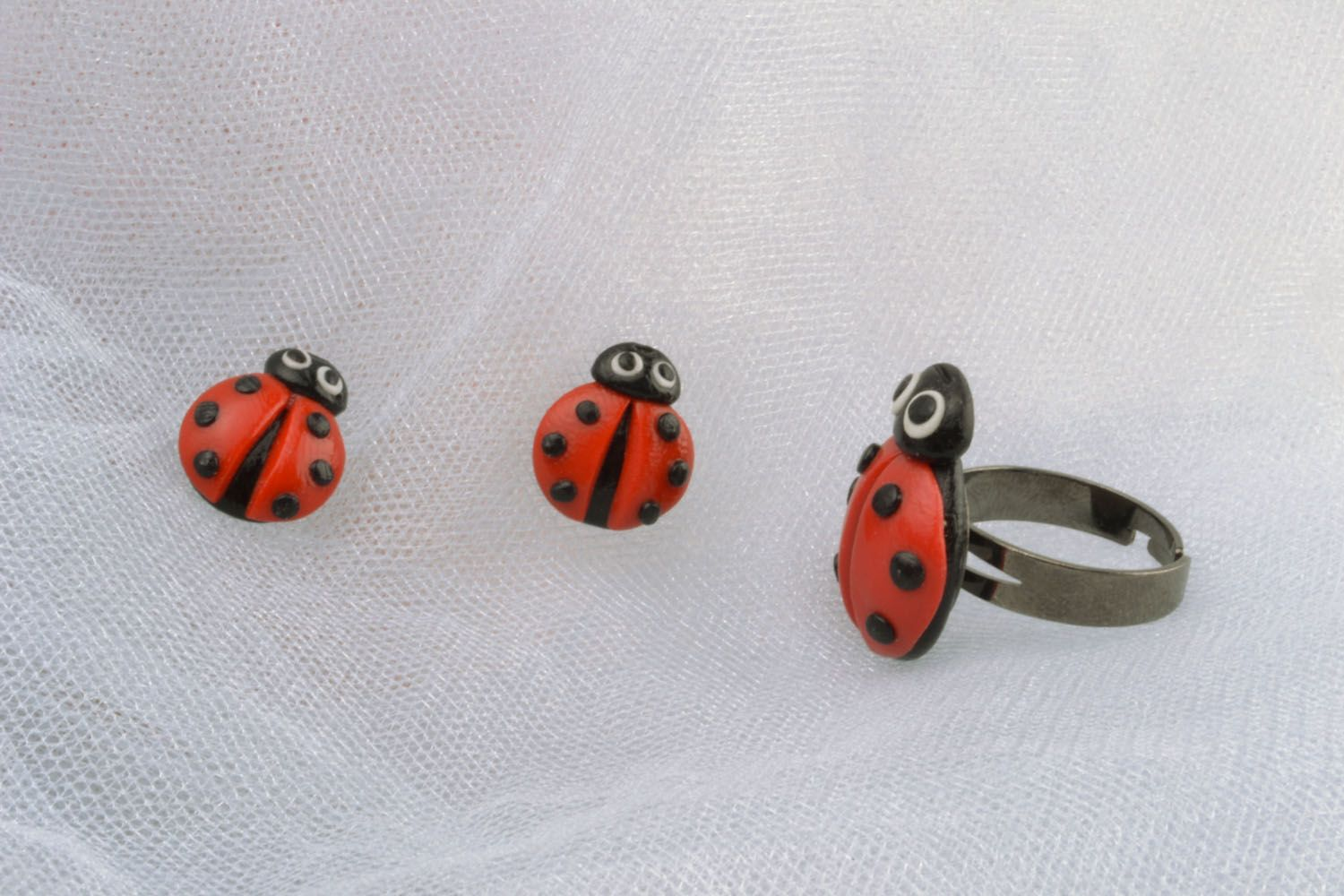 Plastic ring and earrings in the shape of ladybugs photo 1