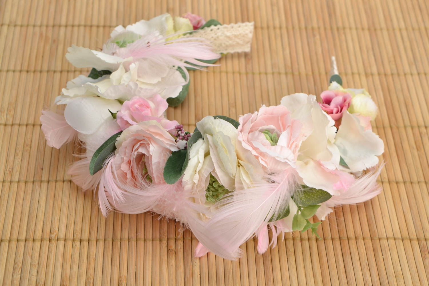 Headband with artificial flowers and feathers photo 1