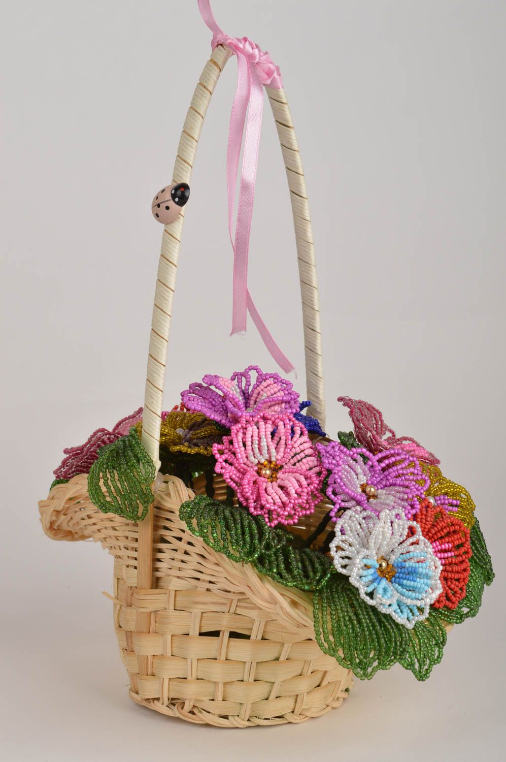 Handmade decorative basket with artificial beaded colorful flowers for interior photo 2