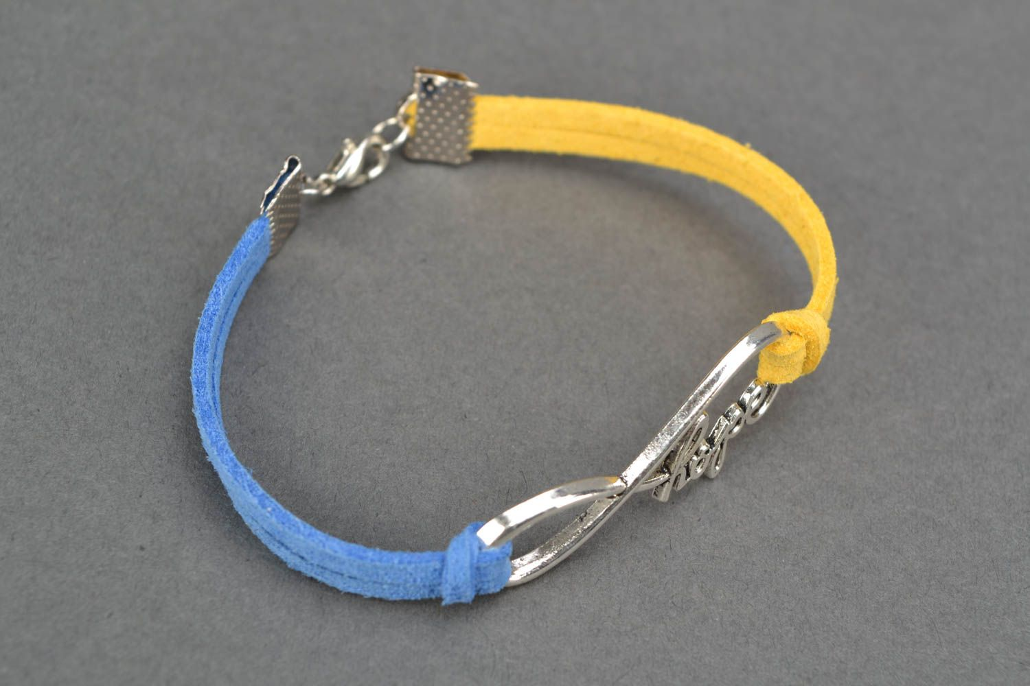 Suede bracelet with metal insert photo 4