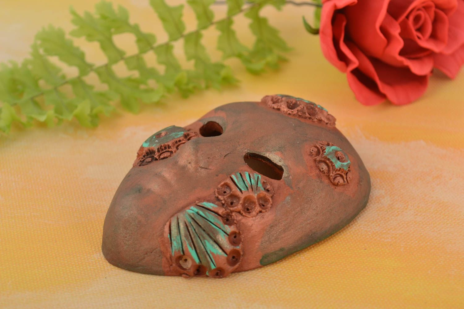 Handmade fridge magnet in shape of souvenir mask made of clay of bronze color photo 1