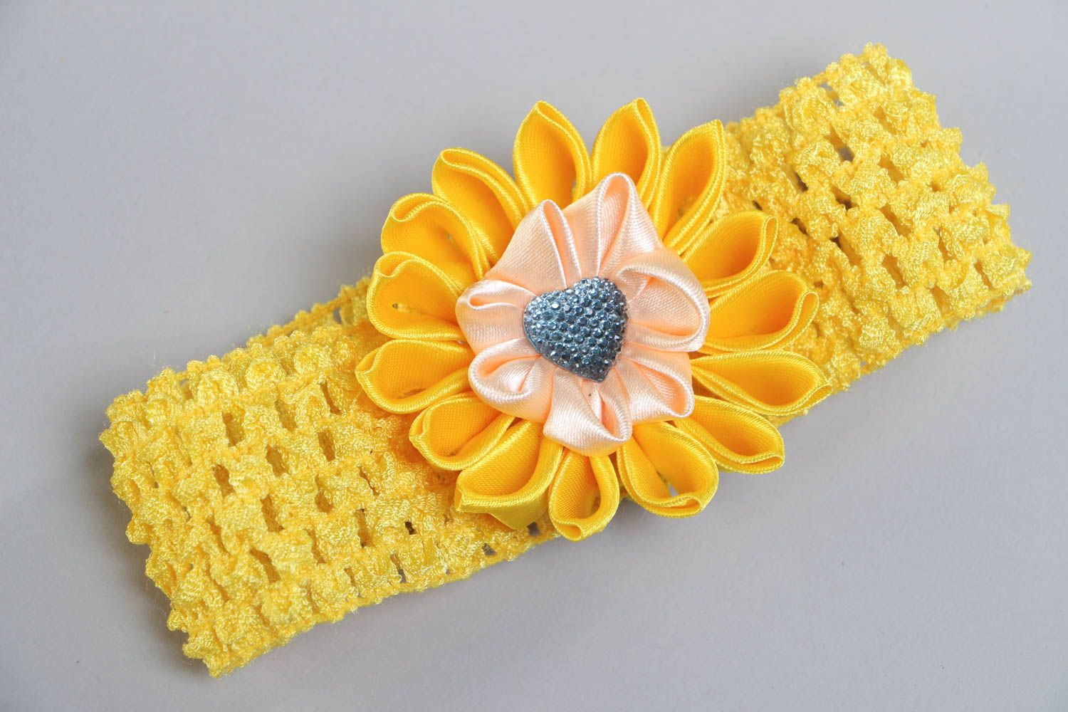 Handmade yellow headband with elastic lacy basis and satin ribbon flower photo 2