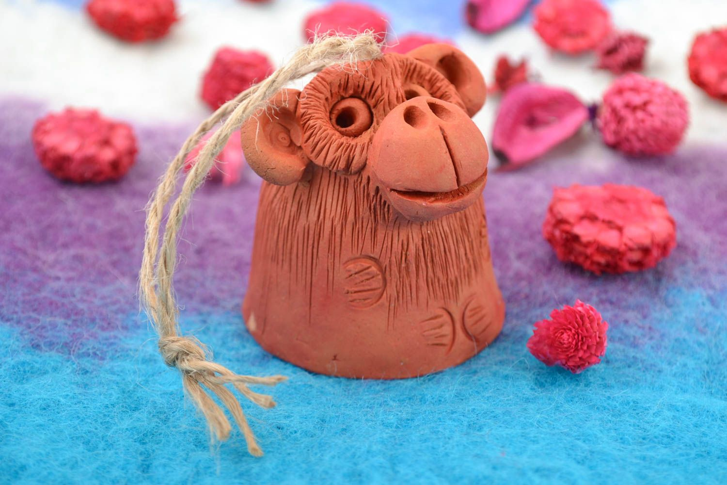 Small funny decorative handmade ceramic bell in the shape of monkey with cord photo 1