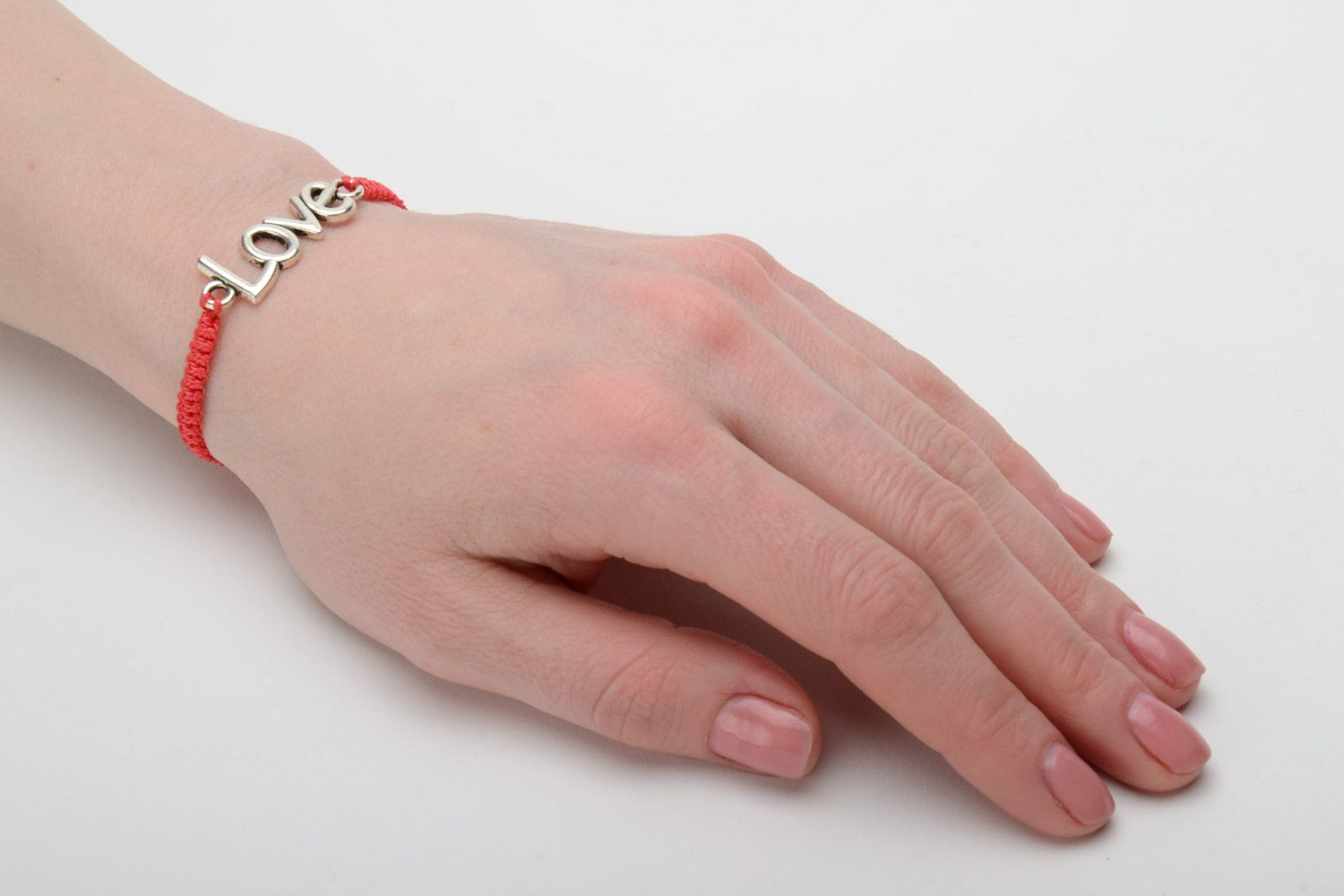 Handmade women's woven cord bracelet of red color with metal charm lettering photo 2