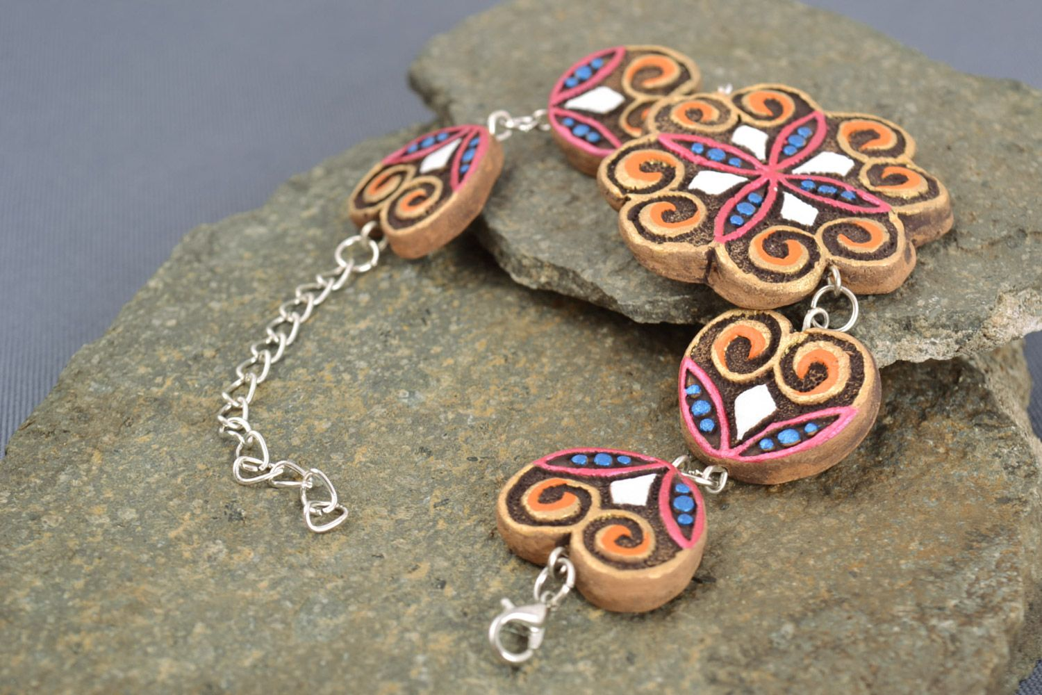 clay bracelets Handmade wrist bracelet with figured ceramic beads painted with ornaments - MADEheart.com