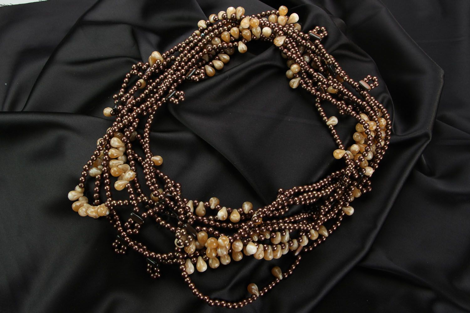 Ethnic beaded necklace in brown and beige colors photo 1