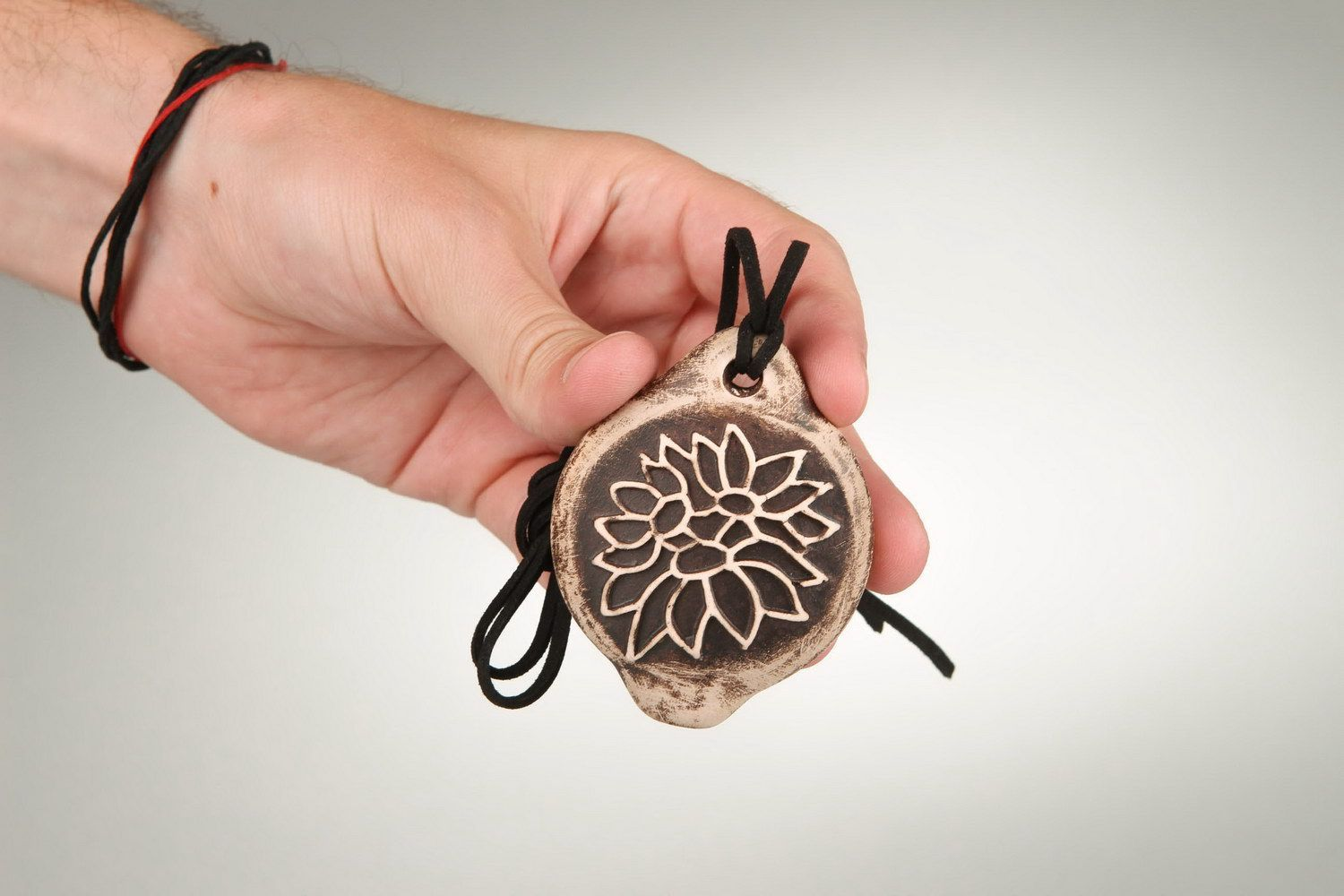 Tin whistle pendant made of clay with carving photo 4
