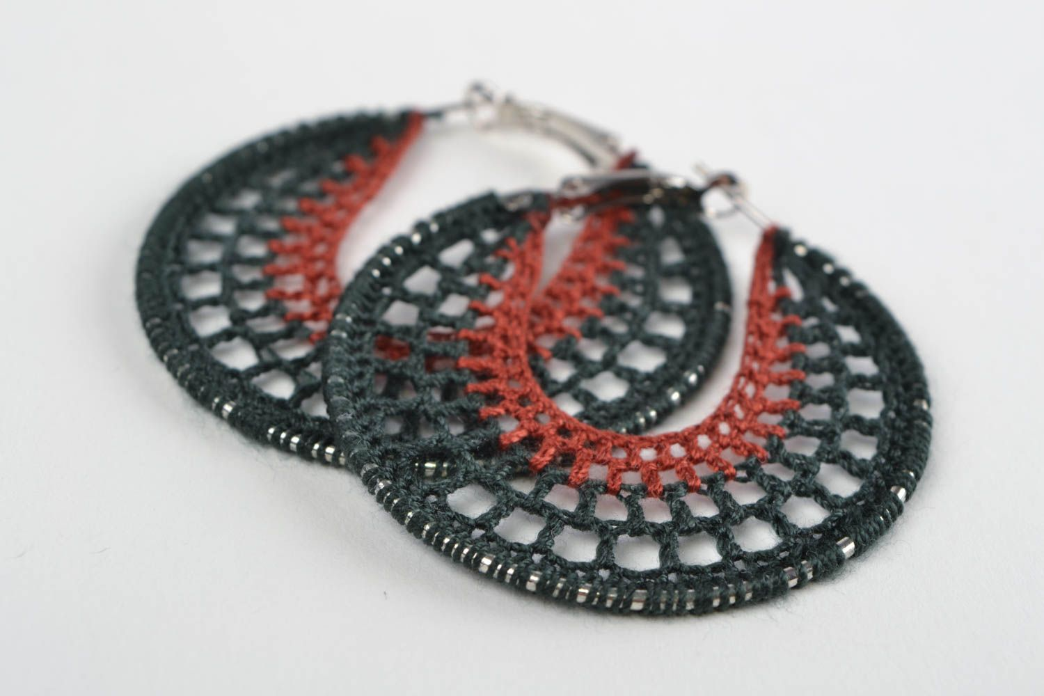 Handmade dangling ring shaped earrings woven of threads on metal round basis photo 1