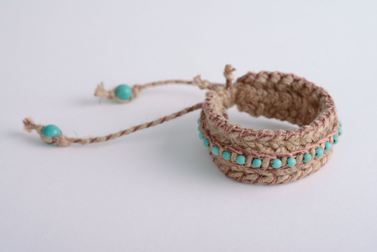 Friendship barcelet woven of jute and linen threads photo 1