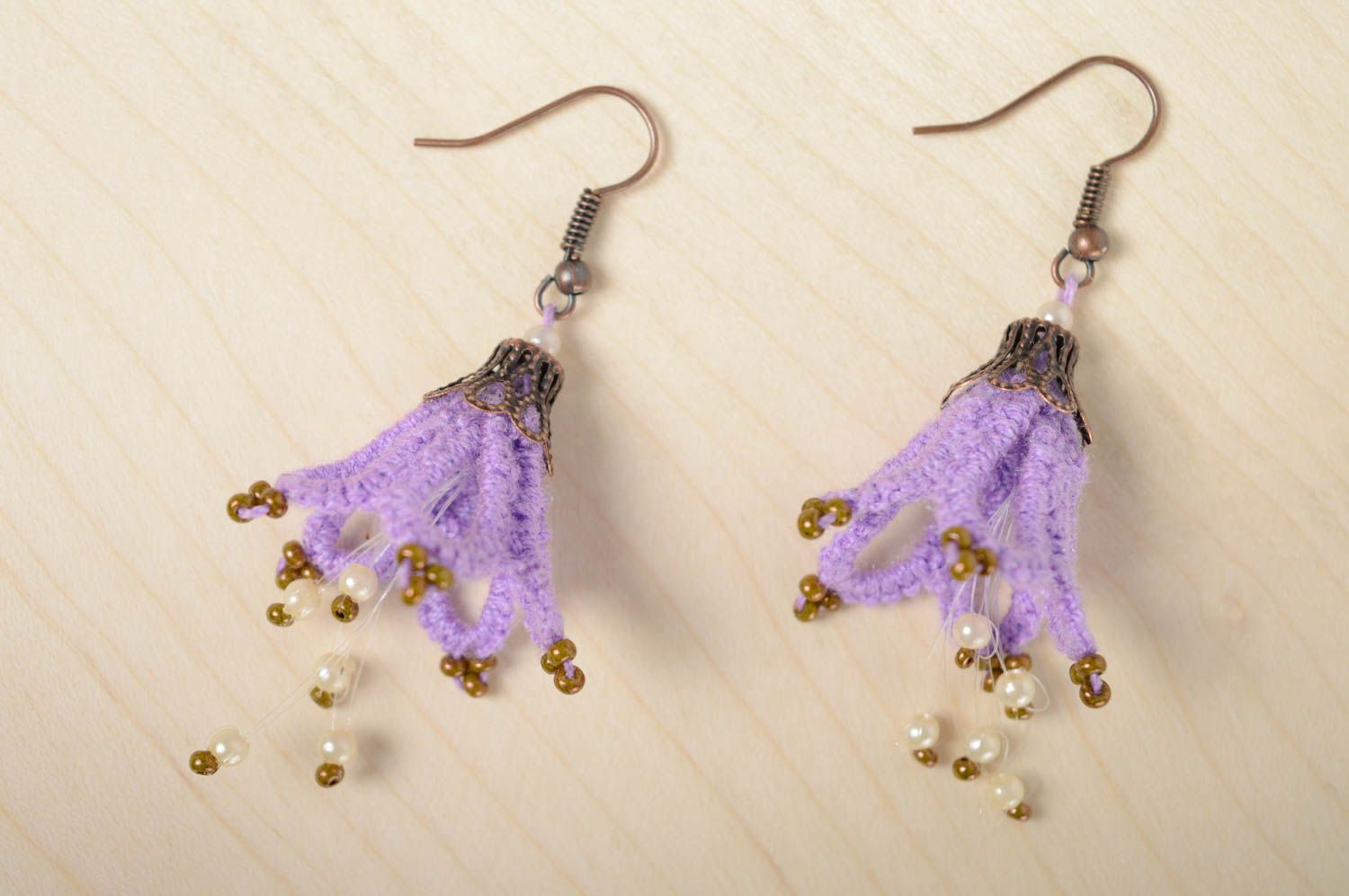 Textile earrings made using tatting technique photo 1