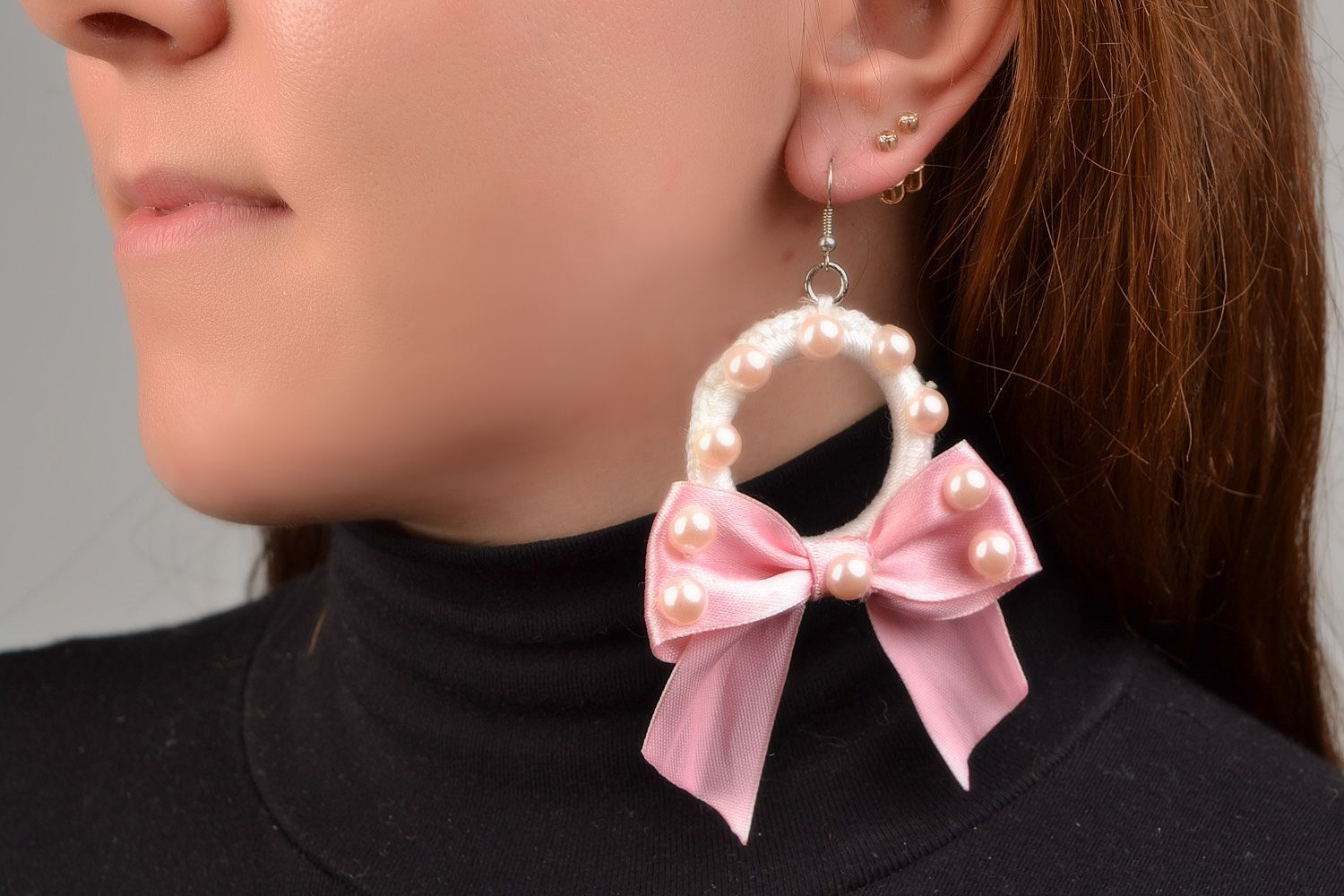 Braided earrings made of plastic rings and threads with pink ribbons present for girlfriend photo 1