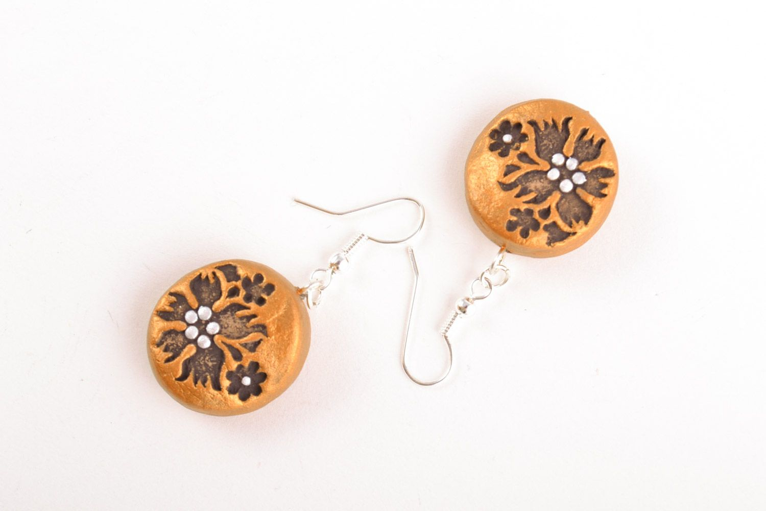 Handmade dangle clay round earrings of gold color with patterns photo 5