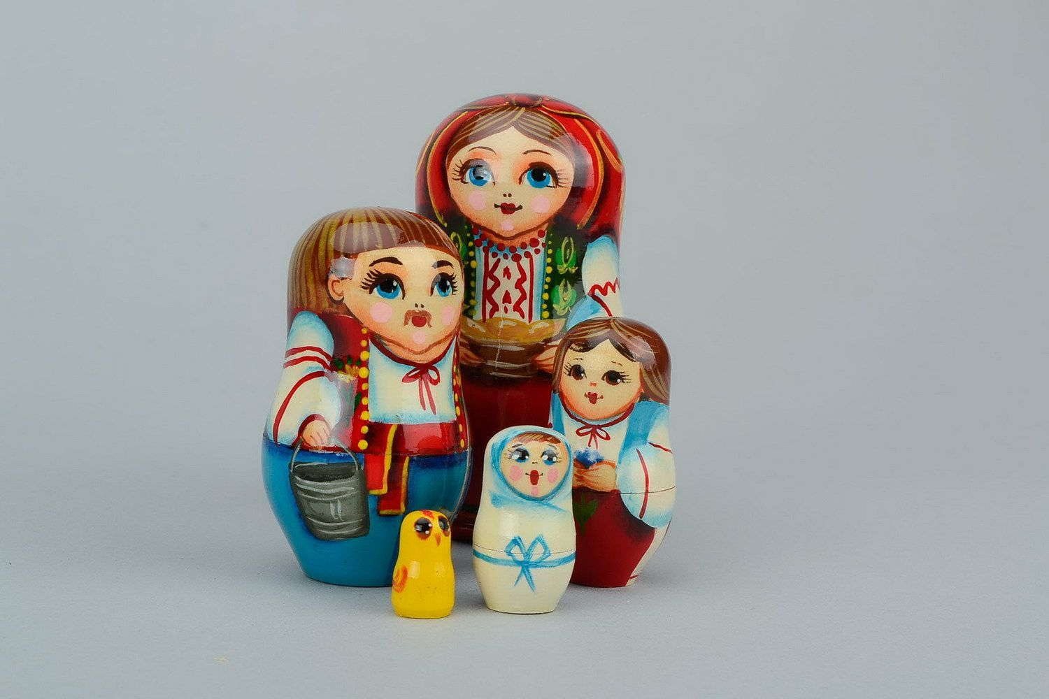 Nesting doll in embroidered shirt with dumplings photo 6