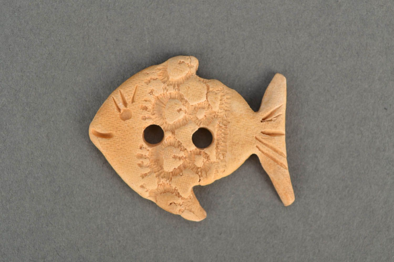 Handmade clay button in the shape of fish photo 1